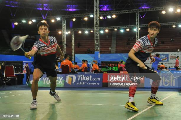 Liu Shiwen and Li Wenmei of China compete against Hiroki Nakayama and Moe Yamaguchi of Japan during Mixed Double qualification round of the BWF World...