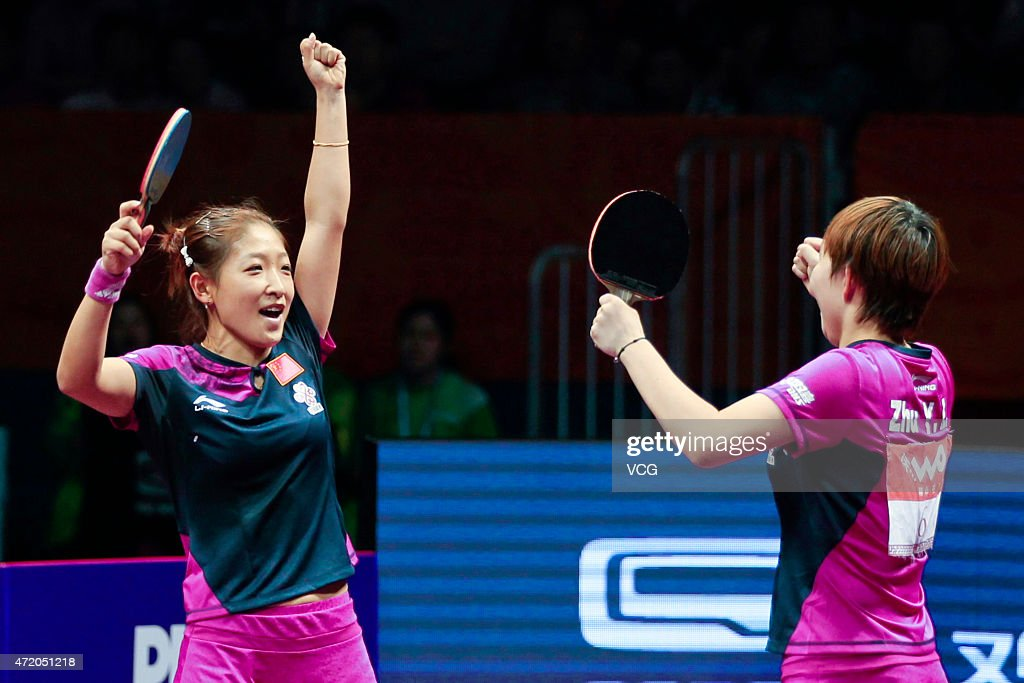 Liu Shiwen (L) and Zhu Yuling of China celebrate after winning women's doubles final match against Ding Ning and Li Xiaoxia of China on day eight of the 2015 World Table Tennis Championships at the Suzhou International Expo Center on May 3, 2015 in Suzhou, China.