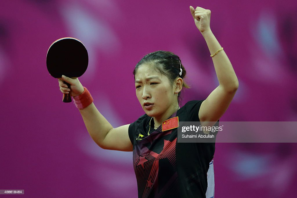 <a gi-track='captionPersonalityLinkClicked' href=/galleries/search?phrase=Liu+Shiwen+-+Table+Tennis+Player&family=editorial&specificpeople=2267824 ng-click='$event.stopPropagation()'>Liu Shiwen</a> of China reacts after defeating Zhu Yuling of China in the women's singles finals gold medal table tennis match on day fifteen of the 2014 Asian Games match at Suwon Gymnasium on October 4, 2014 in Incheon, South Korea.