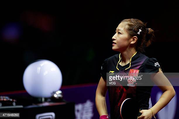 Liu Shiwen of China reacts against Ding Ning of China during women's singles final match on day seven of the 2015 World Table Tennis Championships at...