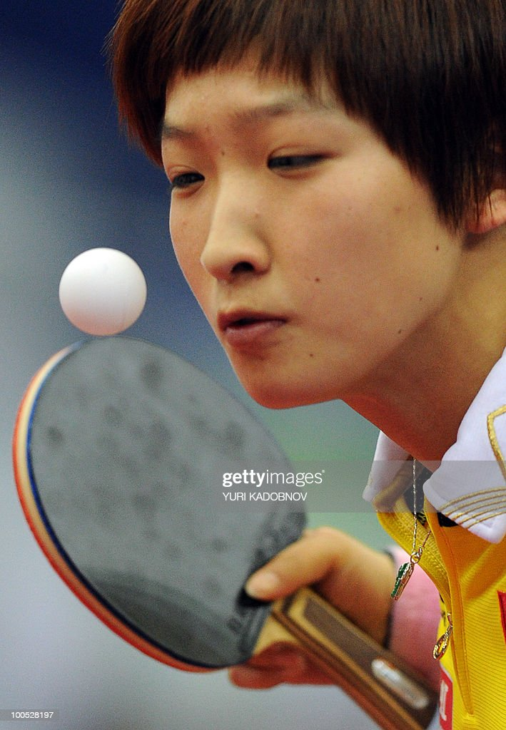 Liu Shiwen of China returns a service to Katarzyna Grybowska of poland during their women's teams group A match at the 2010 World Team Table Tennis Championships in Moscow on May 25, 2010.