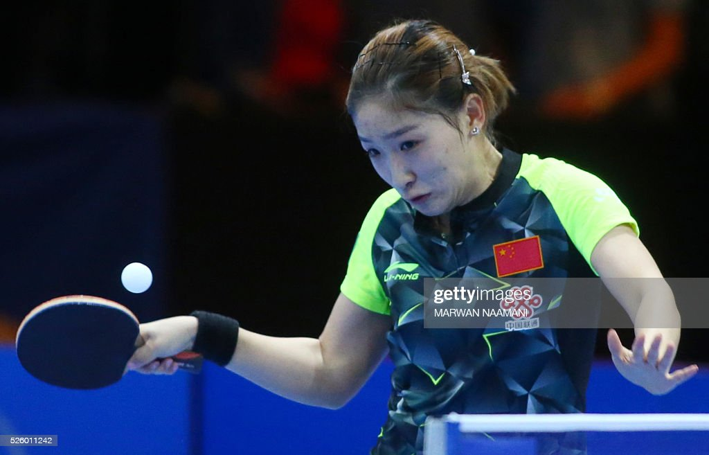 Liu Shiwen of China returns the ball to Tie Yana of Hong Kong during their women's singles semi-final table tennis match in the ITTF Nakheel Table Tennis Asian Cup, on April 29, 2016 in Dubai.. / AFP / MARWAN