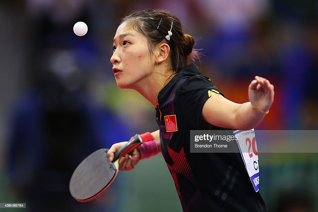 <a gi-track='captionPersonalityLinkClicked' href=/galleries/search?phrase=Liu+Shiwen+-+Table+Tennis+Player&family=editorial&specificpeople=2267824 ng-click='$event.stopPropagation()'>Liu Shiwen</a> of China serves in her Round of 16 Elimination Match against Ri Migyong of North Korea during day thirteen of the 2014 Asian Games at Suwon Gymnasium on October 2, 2014 in Incheon, South Korea.