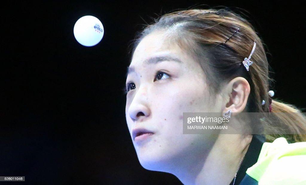 Liu Shiwen of China serves the ball to Tie Yana of Hong Kong during their women's singles semi-final table tennis match in the ITTF Nakheel Table Tennis Asian Cup, on April 29, 2016 in Dubai.. / AFP / MARWAN