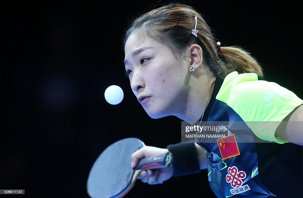 Liu Shiwen of China serves the ball to Tie Yana of Hong Kong during their women's singles semi-final table tennis match in the ITTF Nakheel Table Tennis Asian Cup, on April 29, 2016 in Dubai.. / AFP / MARWAN