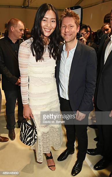 Liu Wen and Christopher Bailey Burberry Chief Creative and Chief Executive Officer pose backstage at the Burberry Womenswear Spring/Summer 2016 show...