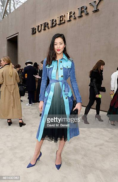 Liu Wen arrives at Burberry Prorsum AW15 London Collections Men at Kensington Gardens on January 12 2015 in London England