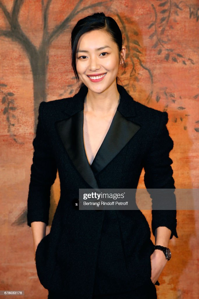 Liu Wen attends the Chanel Cruise 2017/2018 Collection Show at Grand Palais on May 3, 2017 in Paris, France.