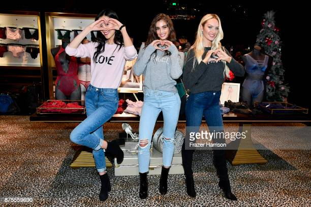 Liu Wen Taylor Hill and Candice Swanpoel pose at the Victoria's Secret Store At Lippo Plaza Appearance at Victoria's Secret on November 18 2017 in...