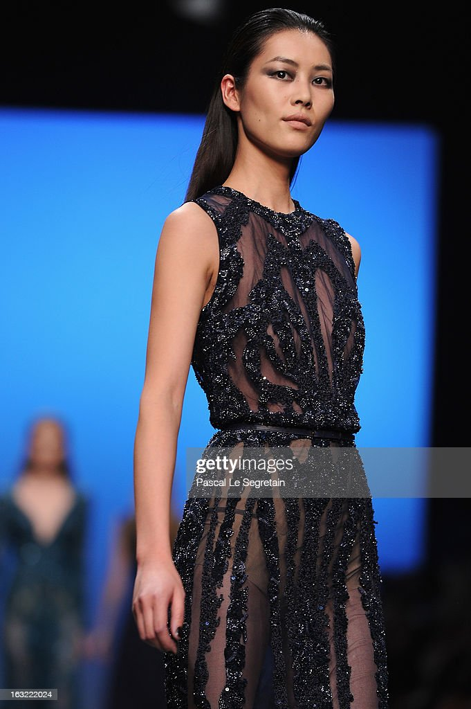 Liu Wen walks the runway at the Elie Saab Fall/Winter 2013 Ready-to-Wear show as part of Paris Fashion Week on March 6, 2013 in Paris, France.