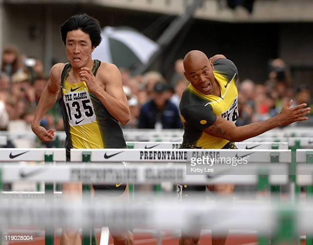 Liu Xiang and Dominique Arnold compete in the 110meter hurdles in the Prefontaine Classic at the University of Oregon's Hayward Field in Eugene Ore...