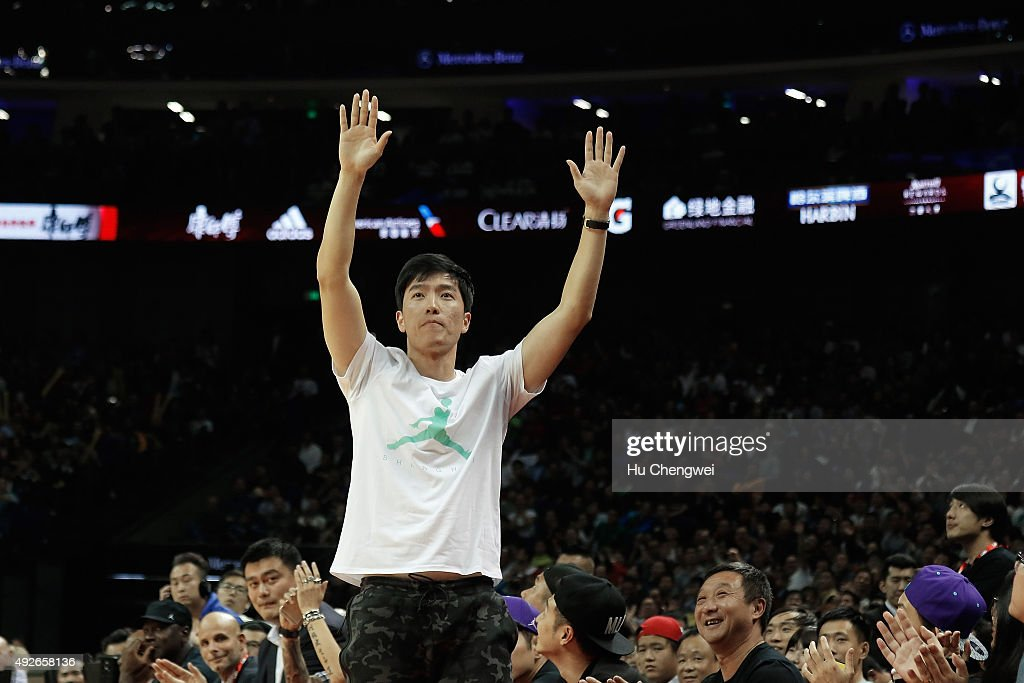 Liu Xiang, greets spectators during a NBA game between Charlotte Hornets and Los Angeles Clippers at Mercedes-Benz Arena on October 14, 2015 in Shanghai, China.