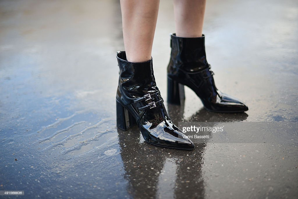 Liu Xiao poses wearing Prada shoes before the Shiatzy Chen show at the Grand Palais during Paris Fashion Week SS16 on October 6 2015 in Paris France