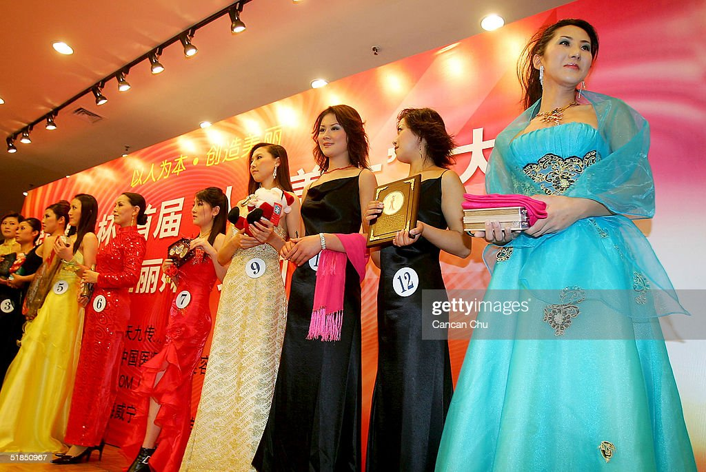 Liu Xiaojing (R), a 22 year-old transsexual, attends a news conference promoting the first Miss Plastic Surgery Contest on December 12, 2004 in Beijing, China. 19 contestants ranging from 17-62 years-old from around China will take part in the contest, officially named 'Artificial Beauty' on December 18. Liu under-went a sex-change operation three years ago.