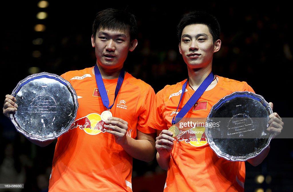 Liu Xiaolong and Qiu Zhan of China celebrate with their trophy's after defeating Hirotuki Endo and Kenichi Hayakawa of Japan in the final of the men's doubles during Day 6 of the Yonex All England Badminton Open at NIA Arena on March 10, 2013 in Birmingham, England.