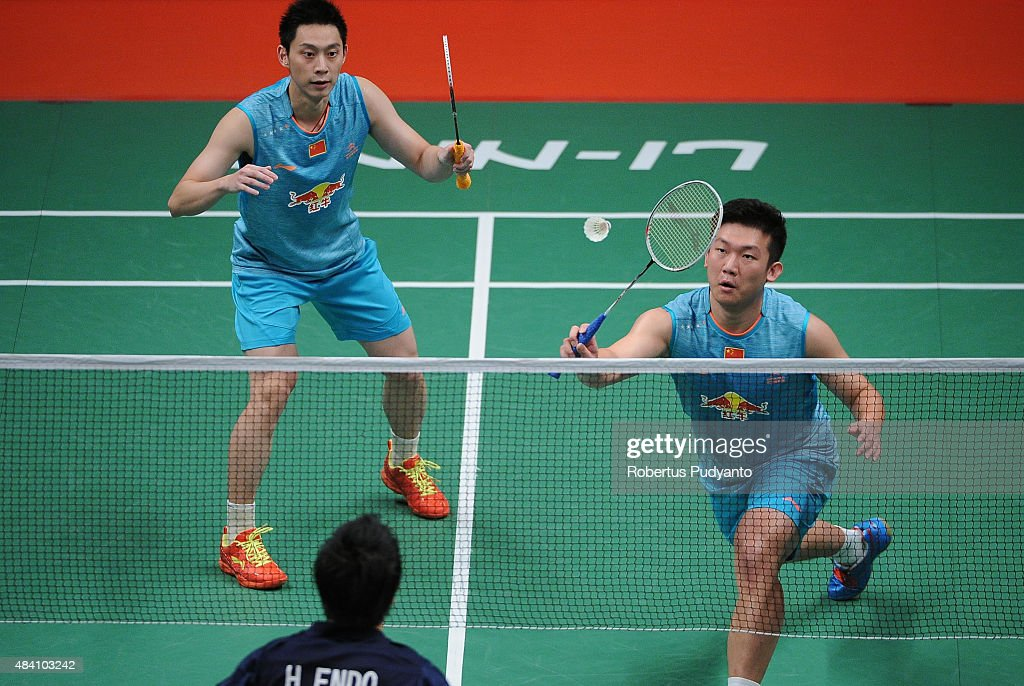 Liu Xiaolong and Qiu Zihan of China compete against <a gi-track='captionPersonalityLinkClicked' href=/galleries/search?phrase=Hiroyuki+Endo&family=editorial&specificpeople=5530229 ng-click='$event.stopPropagation()'>Hiroyuki Endo</a> and Kenichi Hayakawa of Japan in the semi final match of the 2015 Total BWF World Championship at Istora Senayan on August 15, 2015 in Jakarta, Indonesia.