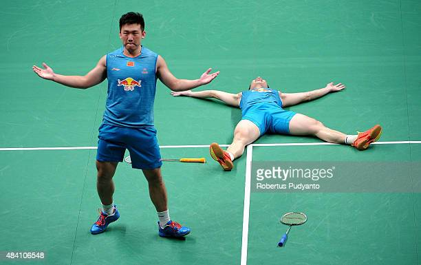 Liu Xiaolong and Qiu Zihan of China react after defeating Hiroyuki Endo and Kenichi Hayakawa of Japan in the semi final match of the 2015 Total BWF...