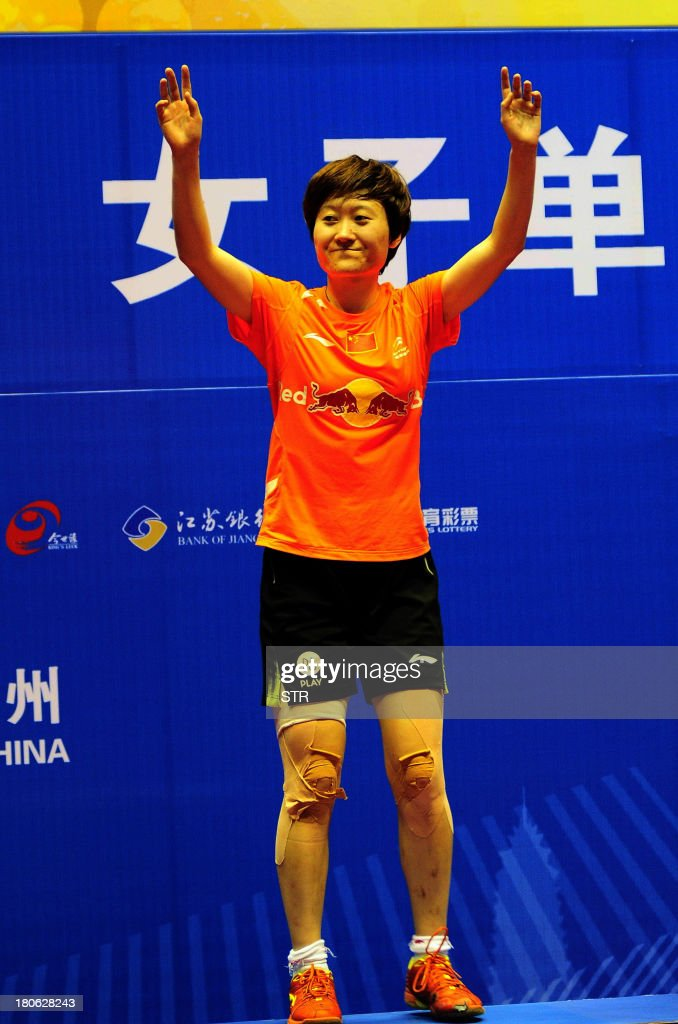 Liu Xin of China celebrates during the award ceremony after beating Porntip Buranaprasertsuk of Thailand in the women's singles final match of the 2013 China Masters in Changzhou, east China's Jiangsu province on September 15, 2013. Liu won 21-4, 13-21, 21-12. CHINA