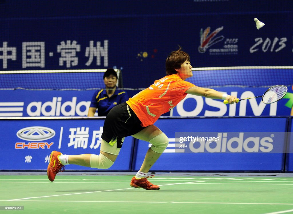 Liu Xin of China returns a shot to Porntip Buranaprasertsuk of Thailand during the women's singles final match of the 2013 China Masters in Changzhou, east China's Jiangsu province on September 15, 2013. Liu won 21-4, 13-21, 21-12. CHINA