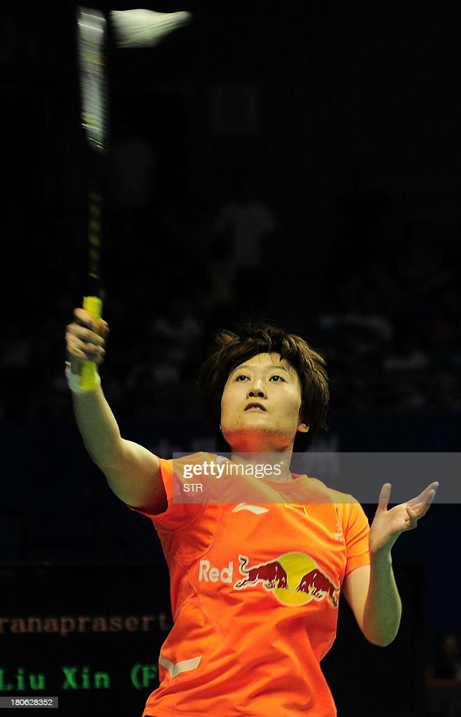 Liu Xin of China returns a shot to Porntip Buranaprasertsuk of Thailand during the women's singles final match of the 2013 China Masters in Changzhou, east China's Jiangsu province on September 15, 2013. Liu won 21-4, 13-21, 21-12. CHINA OUT AFP PHOTO