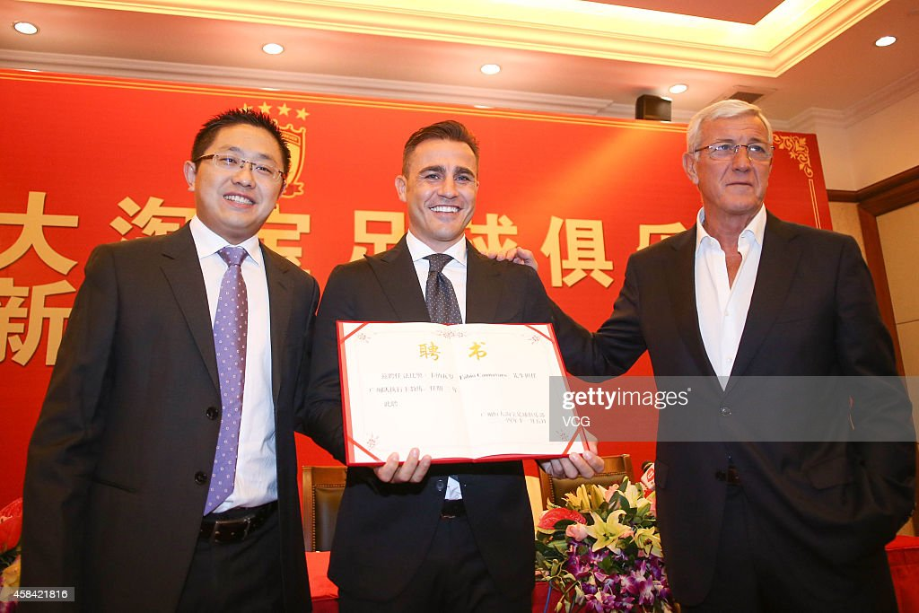 Liu Yongzhuo, Chairman of Guangzhou Evergrande Taobao Football Club, <a gi-track='captionPersonalityLinkClicked' href=/galleries/search?phrase=Fabio+Cannavaro&family=editorial&specificpeople=204335 ng-click='$event.stopPropagation()'>Fabio Cannavaro</a> and <a gi-track='captionPersonalityLinkClicked' href=/galleries/search?phrase=Marcello+Lippi&family=editorial&specificpeople=535060 ng-click='$event.stopPropagation()'>Marcello Lippi</a> pose with <a gi-track='captionPersonalityLinkClicked' href=/galleries/search?phrase=Fabio+Cannavaro&family=editorial&specificpeople=204335 ng-click='$event.stopPropagation()'>Fabio Cannavaro</a>'s Letter of Appointment for a photograph during the press conference announcing <a gi-track='captionPersonalityLinkClicked' href=/galleries/search?phrase=Fabio+Cannavaro&family=editorial&specificpeople=204335 ng-click='$event.stopPropagation()'>Fabio Cannavaro</a> to replace <a gi-track='captionPersonalityLinkClicked' href=/galleries/search?phrase=Marcello+Lippi&family=editorial&specificpeople=535060 ng-click='$event.stopPropagation()'>Marcello Lippi</a> as the head coach at Guangzhou Evergrande Taobao Football Club on November 5, 2014 in Guangzhou, China.