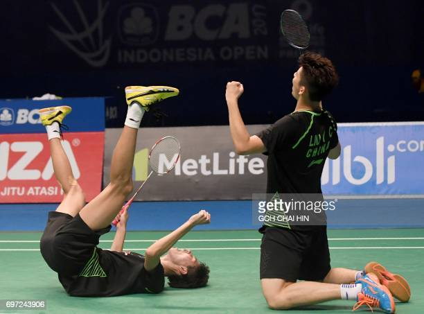 TOPSHOT Liu Yuchen and Li Junhui of China celebrate after beating Mathias Boe and Carsten Mogensen of Denmark to win the men's doubles final at the...