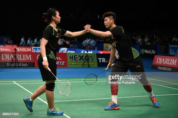 Liu Yuchen and Tang Jinhua of China compete against Rinov Rivaldy and Angelica Wiratama of Indonesia during their qualification round match of the...