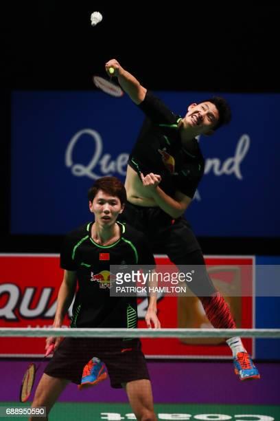 Liu Yuchen hits a return during the men's doubles Sudirman Cup match with partner Li Junhui of China against Takeshi Kamura and Keigo Sonoda of Japan...