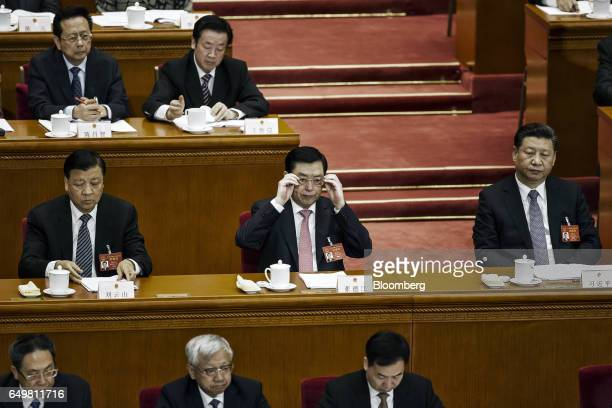 Liu Yunshan deputy general secretary of the Communist Party of China second row from left Zhang Dejiang chairman of the Standing Committee of the...