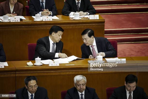 Liu Yunshan deputy general secretary of the Communist Party of China left speaks with Zhang Dejiang chairman of the Standing Committee of the...