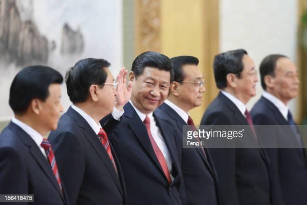 Liu Yunshan Zhang Dejiang Xi Jinping Li Keqiang Yu Zhengsheng and Wang Qishan greet the media at the Great Hall of the People on November 15 2012 in...