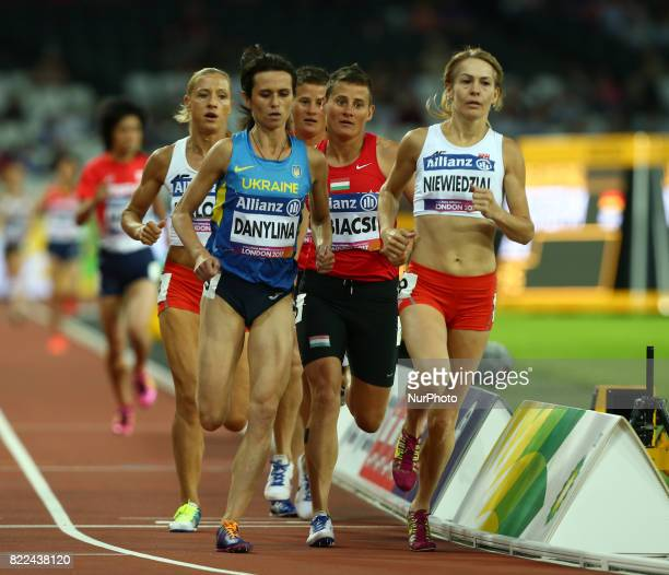 LR Liudmyia Danylina of Ukraine Sayaka Makita of Japen and Barbara Niewiedzial of Poland compete Women's 1500m T20 Final during World Para Athletics...