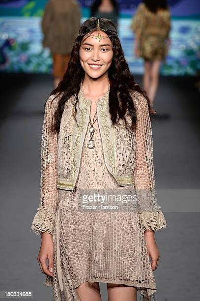 LiuModel Liu Wen walks the runway at the Anna Sui fashion show during MercedesBenz Fashion Week Spring 2014 at The Theatre at Lincoln Center on...