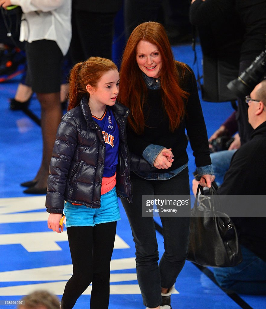 Liv Helen Freundlich and Julianne Moore attend the Minnesota Timberwolves vs New York Knicks game at Madison Square Garden on December 23, 2012 in New York City.