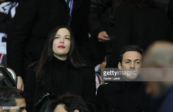 Liv Tyler and David Gardner attend during the UEFA Champions League Round of 16 first leg match between Paris SaintGermain and FC Barcelona at Parc...