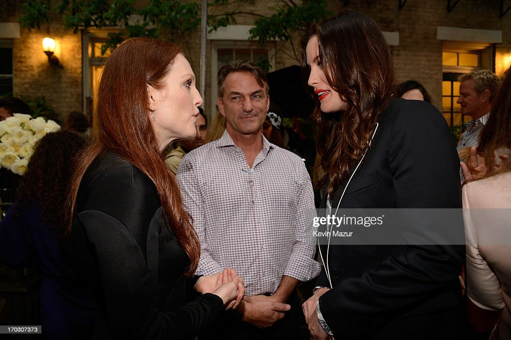 Liv Tyler and Julianne Moore attend the Stella McCartney Spring 2014 Collection Presentation at West 10th Street on June 10, 2013 in New York City.
