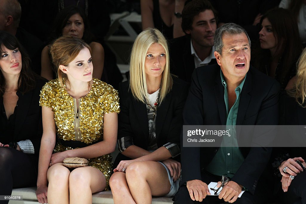 Liv Tyler, Emma Watson, Gwyneth Paltrow and Mario Testino watch the Burberry Prorsum Spring/Summer 2010 Show at Rootstein Hopkins Parade Ground during London Fashion Week on September 22, 2009 in London, England.