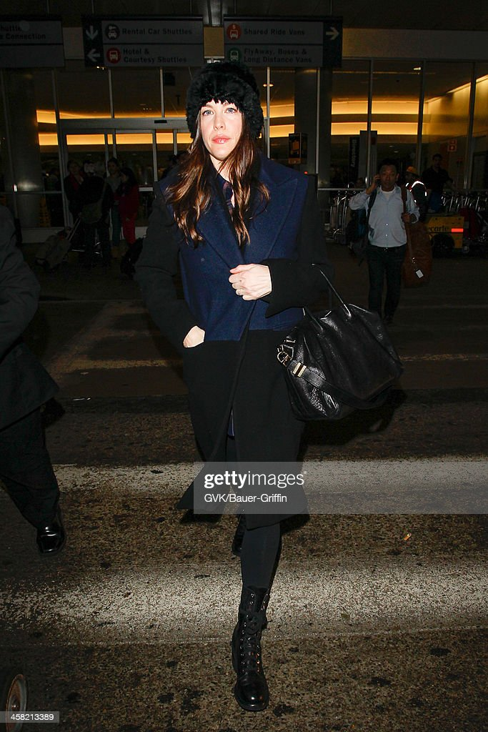 <a gi-track='captionPersonalityLinkClicked' href=/galleries/search?phrase=Liv+Tyler&family=editorial&specificpeople=202094 ng-click='$event.stopPropagation()'>Liv Tyler</a> is seen at LAX airport on December 19, 2013 in Los Angeles, California.