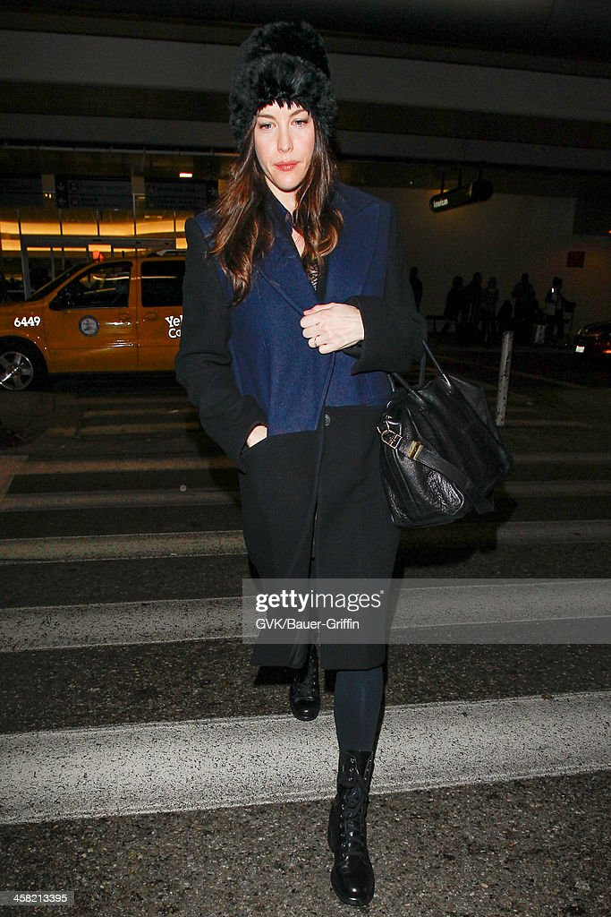 Liv Tyler is seen at LAX airport on December 19, 2013 in Los Angeles, California.