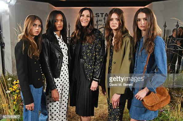 Liv Tyler poses with models as she and Belstaff launch the Spring Summer 17 collection during London Fashion Week at Victoria House on September 18...