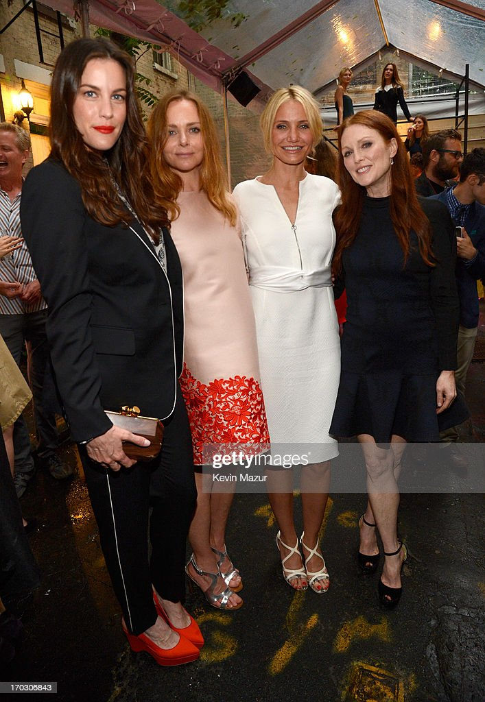 <a gi-track='captionPersonalityLinkClicked' href=/galleries/search?phrase=Liv+Tyler&family=editorial&specificpeople=202094 ng-click='$event.stopPropagation()'>Liv Tyler</a>, Stella McCartney, <a gi-track='captionPersonalityLinkClicked' href=/galleries/search?phrase=Cameron+Diaz&family=editorial&specificpeople=201892 ng-click='$event.stopPropagation()'>Cameron Diaz</a> and <a gi-track='captionPersonalityLinkClicked' href=/galleries/search?phrase=Julianne+Moore&family=editorial&specificpeople=171555 ng-click='$event.stopPropagation()'>Julianne Moore</a> attend the Stella McCartney Spring 2014 Collection Presentation at West 10th Street on June 10, 2013 in New York City.
