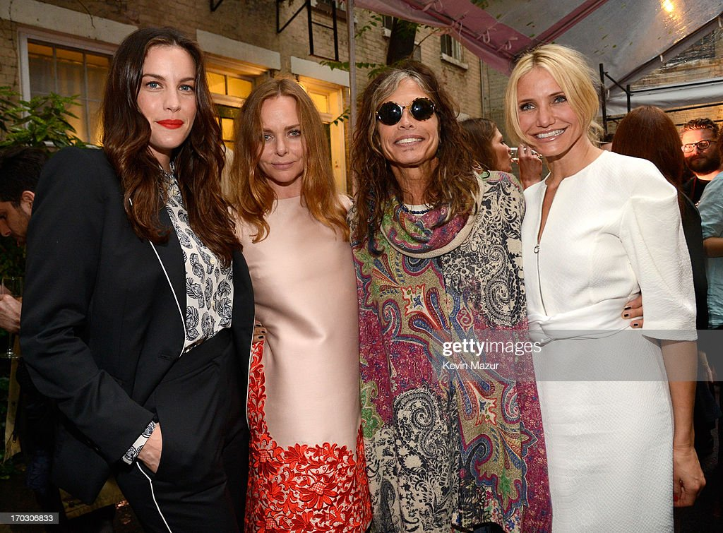 <a gi-track='captionPersonalityLinkClicked' href=/galleries/search?phrase=Liv+Tyler&family=editorial&specificpeople=202094 ng-click='$event.stopPropagation()'>Liv Tyler</a>, Stella McCartney, <a gi-track='captionPersonalityLinkClicked' href=/galleries/search?phrase=Steven+Tyler+-+Musician&family=editorial&specificpeople=202080 ng-click='$event.stopPropagation()'>Steven Tyler</a> and <a gi-track='captionPersonalityLinkClicked' href=/galleries/search?phrase=Cameron+Diaz&family=editorial&specificpeople=201892 ng-click='$event.stopPropagation()'>Cameron Diaz</a> attend the Stella McCartney Spring 2014 Collection Presentation at West 10th Street on June 10, 2013 in New York City.