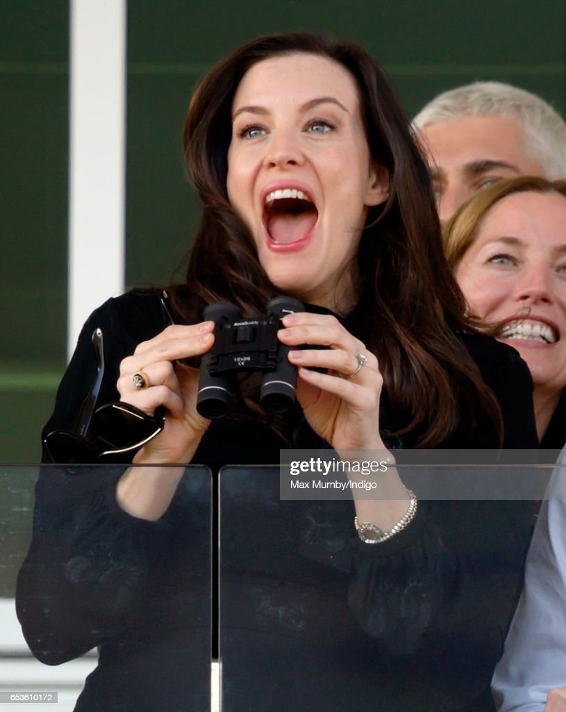Liv Tyler watches the racing as she attends day 2 'Ladies Day' of the Cheltenham Festival at Cheltenham Racecourse on March 15, 2017 in Cheltenham, England.