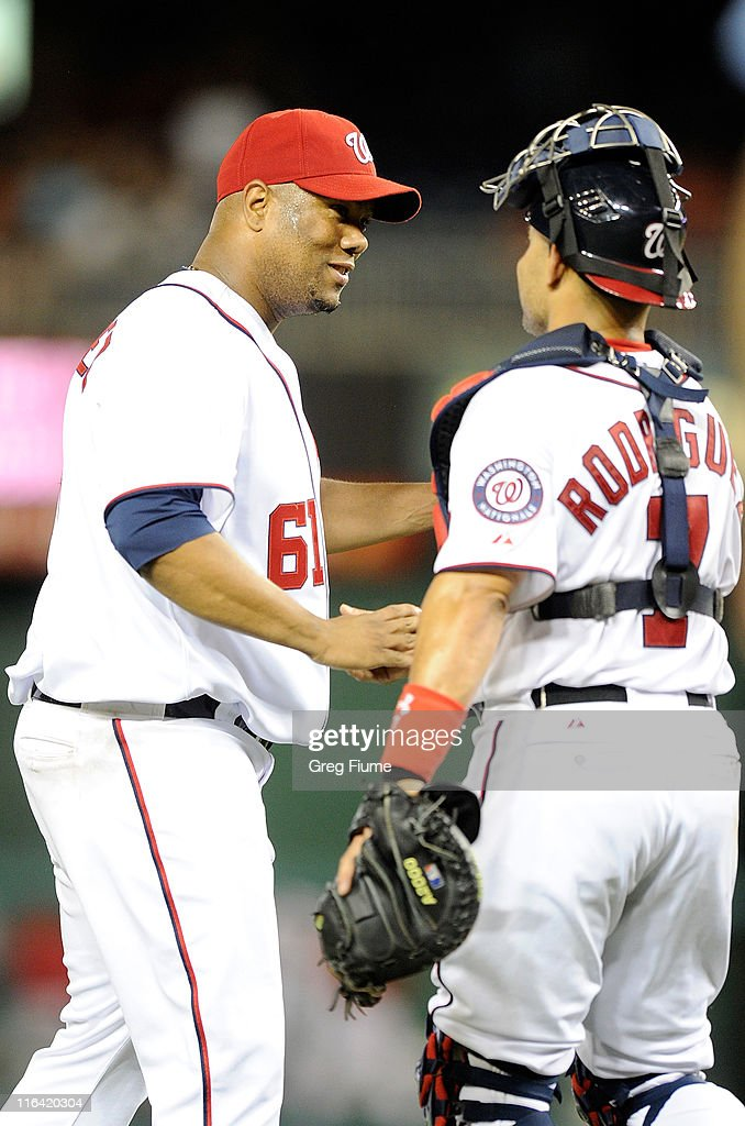 Livan Hernandez #61 of the Washington Nationals celebrates with Ivan Rodriguez #7 after pitching a complete game 10-0 shutout against the St. Louis Cardinals at Nationals Park on June 15, 2011 in Washington, DC.