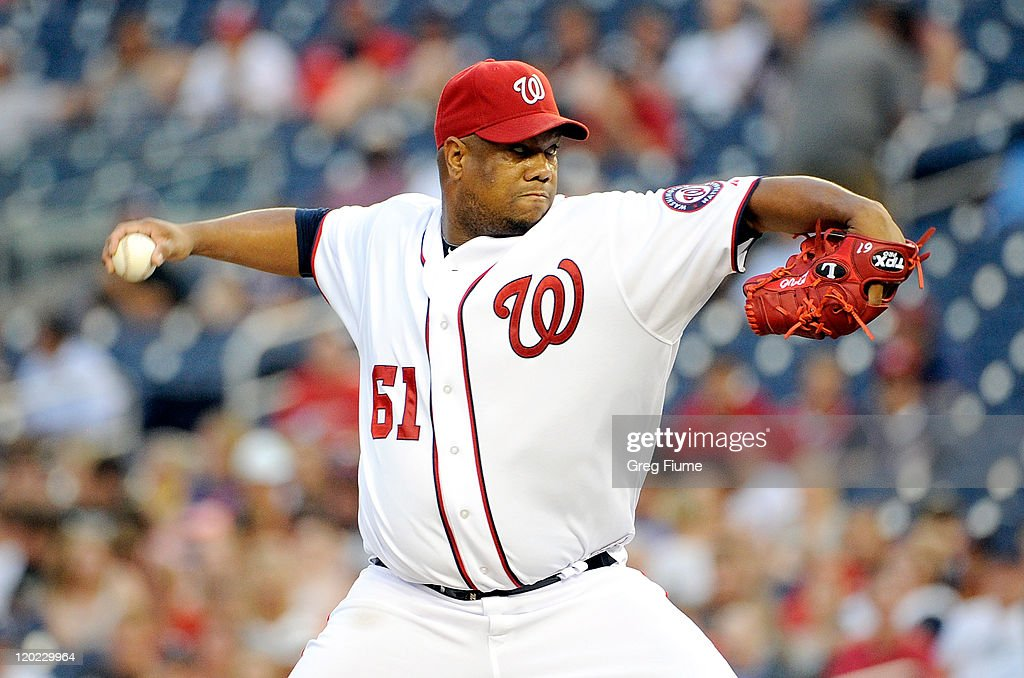 <a gi-track='captionPersonalityLinkClicked' href=/galleries/search?phrase=Livan+Hernandez&family=editorial&specificpeople=203042 ng-click='$event.stopPropagation()'>Livan Hernandez</a> #61 of the Washington Nationals pitches against the Atlanta Braves at Nationals Park on August 1, 2011 in Washington, DC.