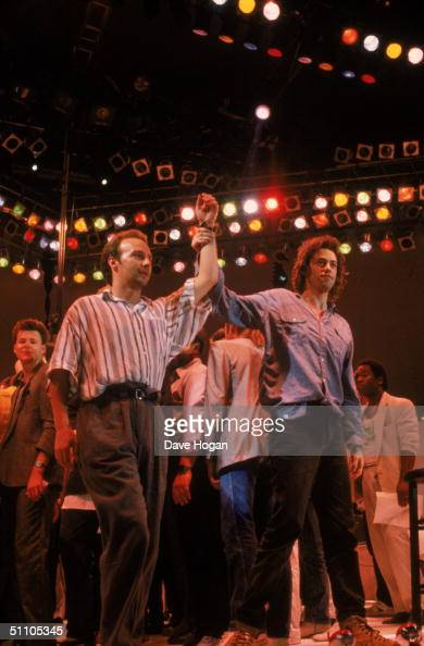 Live Aid organisers Midge Ure and Bob Geldof on stage at the Live Aid charity concert Wembley Stadium London 13th July 1985