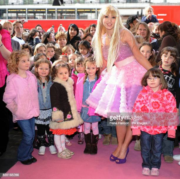 A live 'Barbie' arrives at Hamleys toy store in London where the iconic doll's 50th birthday was celebrated
