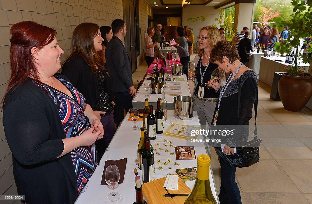 Live In The Vineyard attendees enjoy wine tasting at the Westin Verasa on November 2, 2012 in Napa, California.