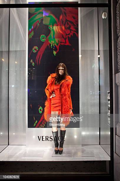 A live model poses in a window display at the Versace store on Fifth Avenue during the second annual Fashion's Night Out in New York US on Friday...