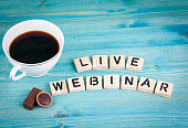 live webinar. Coffee mug and wooden letters on wooden background.